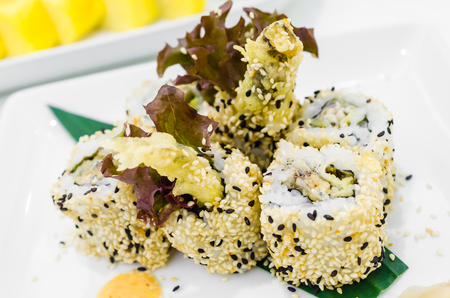 Sesame and fish eggs sushi photo