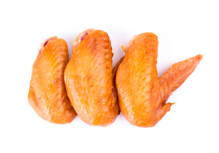 Smoked chicken wings on white photo