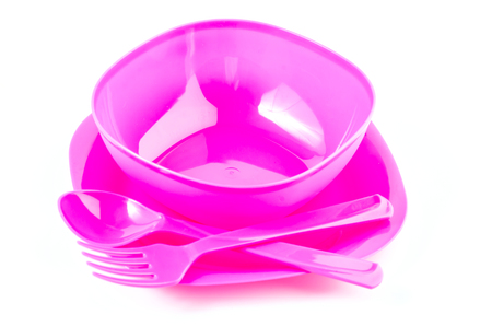 Color plastic tableware dishes , spoon and fork photo
