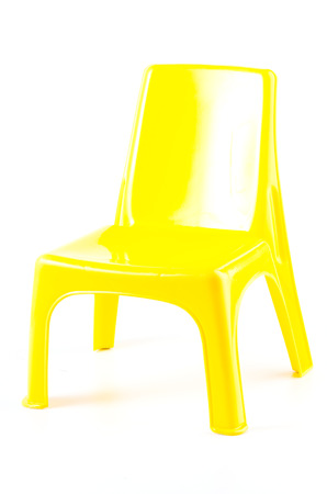 patio chair: Yellow plastic chair on isolated white Stock Photo