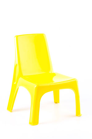 patio furniture: Yellow plastic chair on isolated white background