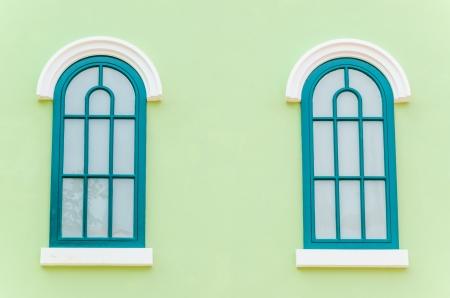 window frame: Beautiful window on color wall