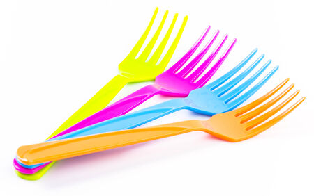Color plastic tableware dishes , spoon , fork photo