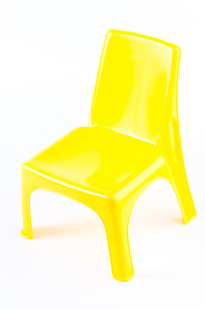 porch chair: Yellow plastic chair on isolated white background