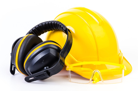 personal protective equipment: Safety equipment on isolated white background , Safety helmet , ears protection , eyes protection