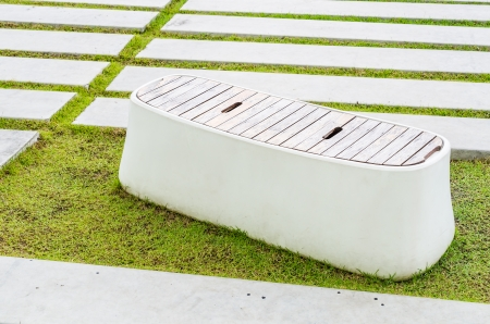 Modern bench on green grass Stock Photo - 24621798