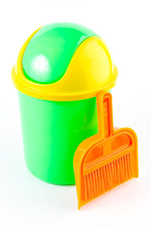 Trash and broom on isolated white background photo