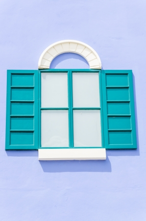 Beautiful window on color wall photo