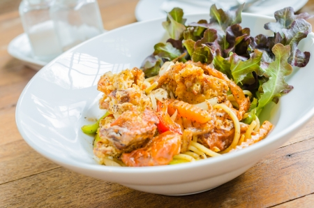 Spaghetti with soft shell crab in black pepper sauce photo