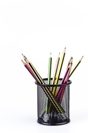 Color pencil in pail on isolated white background photo