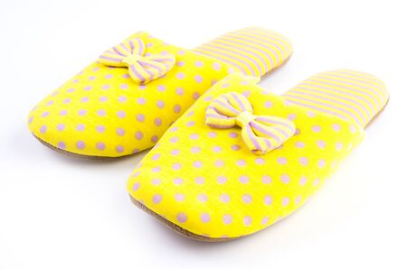 Yellow house slippers isolated on white background photo