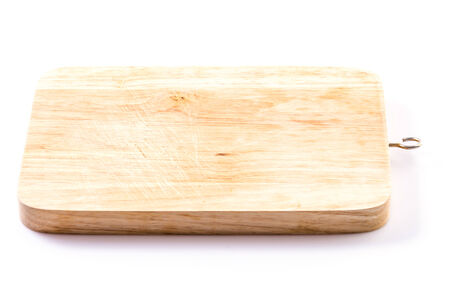 Wood cutting board on isolated white background photo