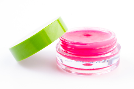 Lip balm on isolated white background photo