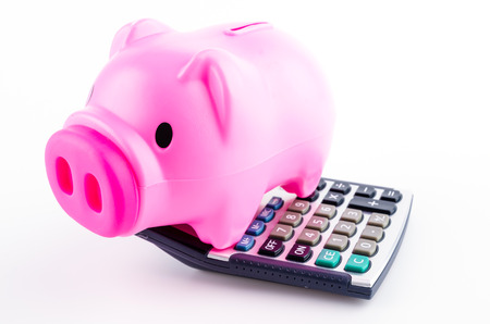 piggy bank calculator isolated white background photo