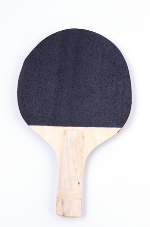 Table tennis racquet on isolated white background photo