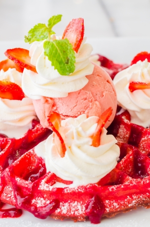 Strawberry waffle served with ice cream photo