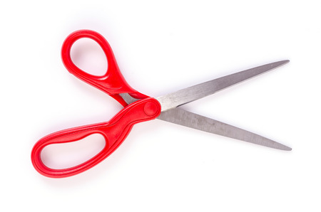 Red scissors on isolated white background
