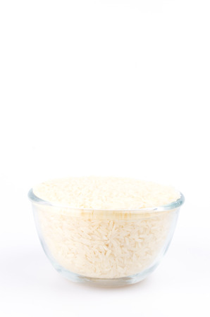 Bowl rice on isolated white background photo