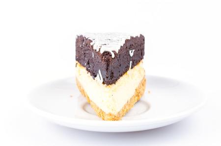 Brownie cheese cake on white background photo