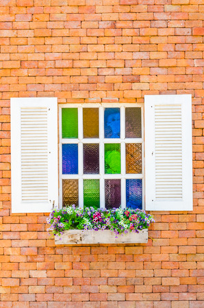 Window on brick wall photo