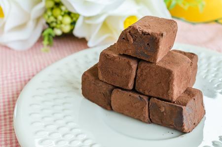 Chocolate on white dish photo
