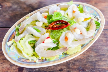 Raw shrimp with spicy sauce photo