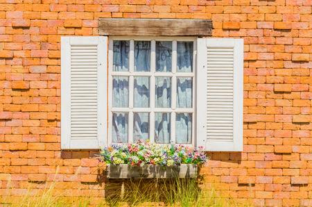 Window on brick wall photo