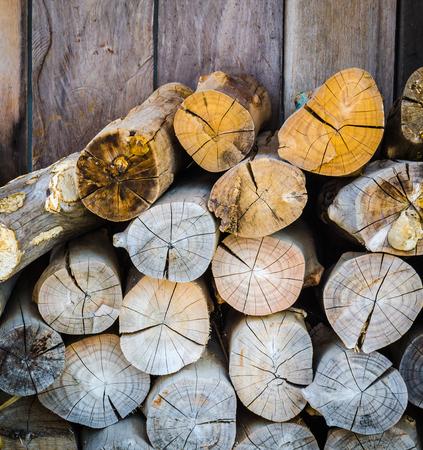 firewood on wood background photo