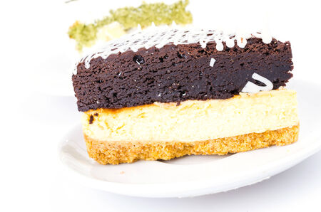 Brownie cheese cake and green tea cake on white background photo