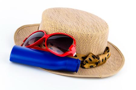 Women hat , lotion , sunglasses isolated on white background photo