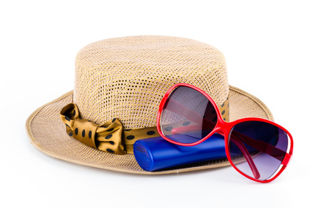 Women hat , lotion , sunglasses isolated on white background photo