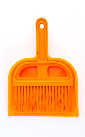 Plastic broom on isolated white background photo