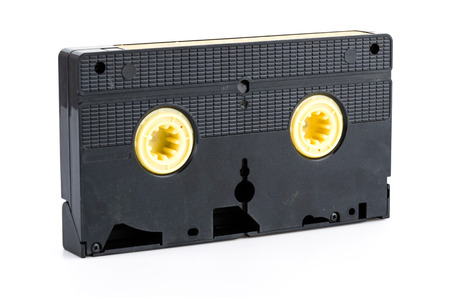 vhs videotape: Old video tape isolated on white background
