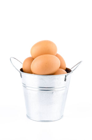 Eggs bucket isolated white  photo
