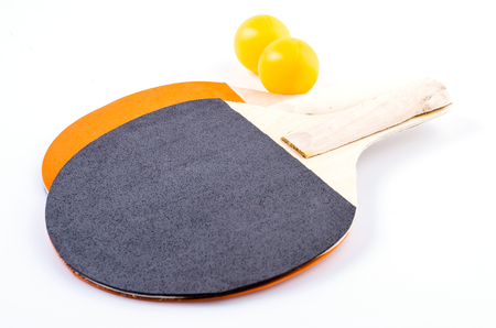 Table tennis and racquet on isolated white background photo