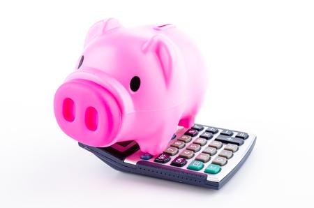 piggy bank calculator isolated white background photo