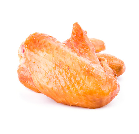 Smoked chicken wings on white background photo