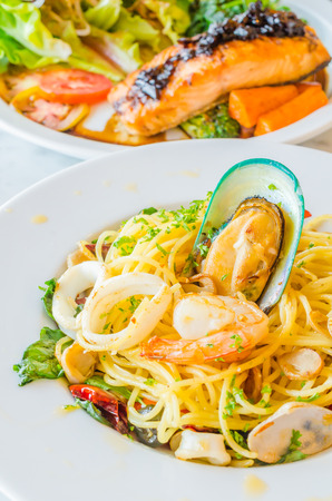 Spaghetti seafood in white dish on the stone table Stock Photo