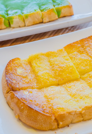 whie: Bread with butter&sugar on top in whie dish