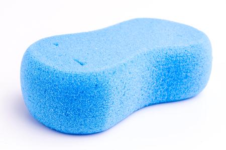 Blue Sponge on isolated white background photo