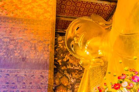 reclining Buddha in wat pho bangkok thailand photo
