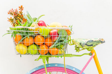 Bicycle with basket fruit and flower photo