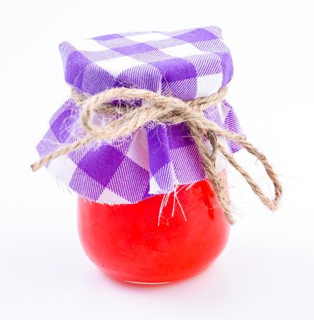 Strawberry jam on isolated white background photo