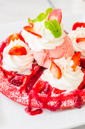 Strawberry waffle served with icecream photo