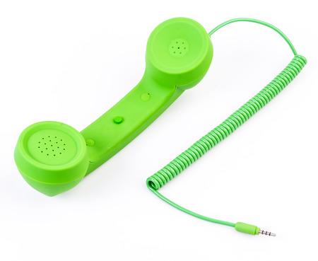 Green telephone on isolated white background