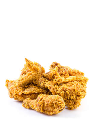 Crispy fried chicken meat on isolated white background photo