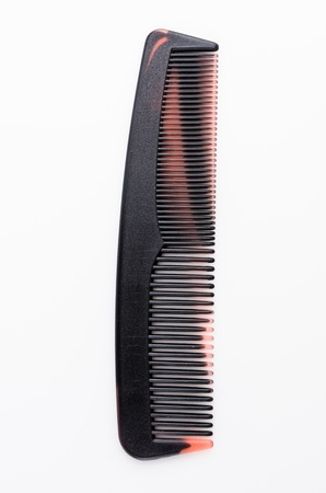 hairstylists: Pocket comb on isolated white background