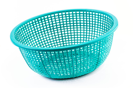 Plastic basket on isolated white background photo