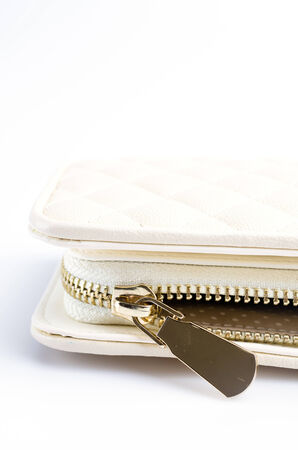 Close up gold zip wallet photo