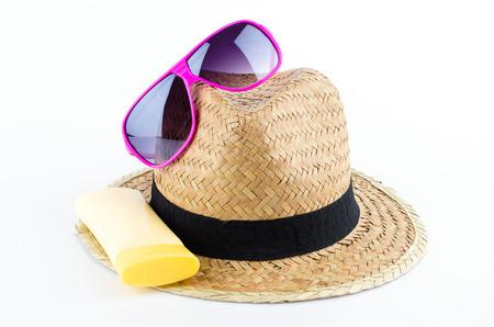 Hat , sunglasses , body lotion isolated on white background photo